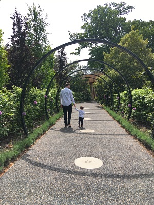 The Neu Dad and his son Marley walking in to the Children's Garden at Kew Gardens